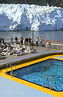 Holland-America Cruise Lines, Veendam.  Passengers at pool.  Margerie Glacier, Glacier Bay National Park, Alaska.