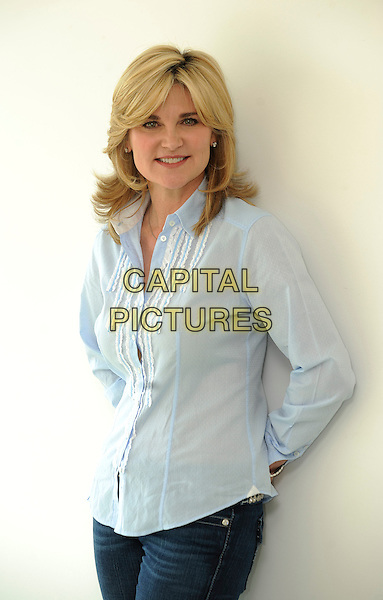 ANTHEA TURNER.Pictured In Central London, England, UK, April 19th 2011..half length studio session blue shirt jeans arms folded crossed .CAP/FIN.©Steve Finn/Capital Pictures.