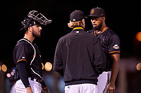 San Jose Giants relief pitcher Joey Marciano (54) talks to pitching coach Matt Yourkin (16) and catcher Joey Bart (9) during a California League game against the Visalia Rawhide on April 12, 2019 at San Jose Municipal Stadium in San Jose, California. Visalia defeated San Jose 6-2. (Zachary Lucy/Four Seam Images)
