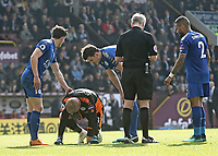 Leicester City's Kasper Schmeichel is injured by Burnley's Ashley Barnes (not pictured) who was shown a yellow card by Referee Martin Atkinson for the challenge<br /> <br /> Photographer Rich Linley/CameraSport<br /> <br /> The Premier League - Burnley v Leicester City - Saturday 14th April 2018 - Turf Moor - Burnley<br /> <br /> World Copyright &copy; 2018 CameraSport. All rights reserved. 43 Linden Ave. Countesthorpe. Leicester. England. LE8 5PG - Tel: +44 (0) 116 277 4147 - admin@camerasport.com - www.camerasport.com