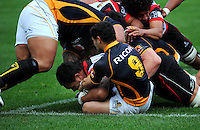 Wellington halfback Ruki Tipuna holds Counties-Manukau lock Taiasina Tuifua up on the tryline. ITM Cup - Wellington Lions v Counties-Manukau Steelers at Westpac Stadium, Wellington, New Zealand on Sunday, 8 August 2010. Photo: Dave Lintott/lintottphoto.co.nz.