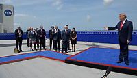 In this photo released by the National Aeronautics and Space Administration (NASA), United States President Donald J. Trump congratulates NASA Administrator Jim Bridenstine, hand on chest, at the Operations Support Building II after the launch of a SpaceX Falcon 9 rocket carrying the company's Crew Dragon spacecraft on NASA's SpaceX Demo-2 mission with NASA astronauts Robert Behnken and Douglas Hurley onboard, Saturday, May 30, 2020, at NASA's Kennedy Space Center in Florida. NASA's SpaceX Demo-2 mission is the first launch with astronauts of the SpaceX Crew Dragon spacecraft and Falcon 9 rocket to the International Space Station as part of the agency's Commercial Crew Program. The test flight serves as an end-to-end demonstration of SpaceX's crew transportation system. Behnken and Hurley launched at 3:22 p.m. EDT on Saturday, May 30, from Launch Complex 39A at the Kennedy Space Center. A new era of human spaceflight is set to begin as American astronauts once again launch on an American rocket from American soil to low-Earth orbit for the first time since the conclusion of the Space Shuttle Program in 2011. <br /> Mandatory Credit: Bill Ingalls / NASA via CNP/AdMedia