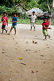 PHILIPPINES, Palawan, Barangay region, Batak boys play with their hand made toys in Kalakwasan Village