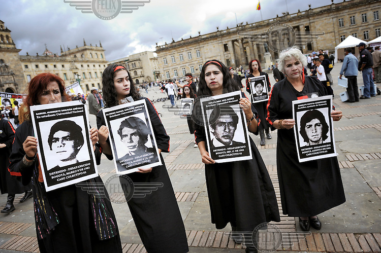Relatives of missing people, assumed to be victims of paramilitary groups, demonstrate in Bolivar Square.