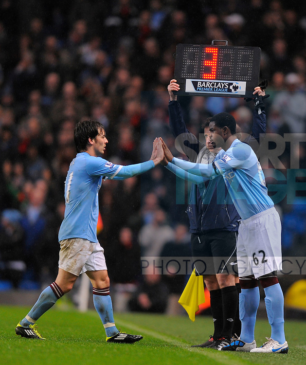 David Silva of Manchester City replaced by Abdul Razak of Manchester City
