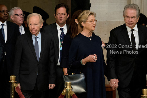 Former Connecticut Sen. Joe Lieberman, left, and actors Warren Beatty, right, and his wife Annette Bening, second from right, arrive in the Rotunda before the casket of Sen. John McCain, R-Ariz., lies in state at the U.S. Capitol, Friday, Aug. 31, 2018, in Washington. (AP Photo/Andrew Harnik, Pool)