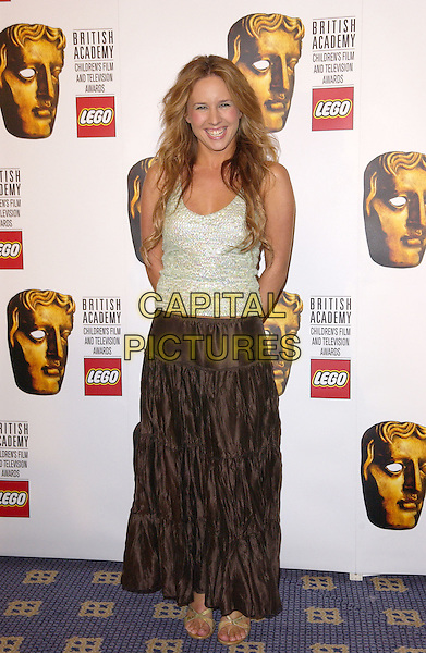 LUCIE SILVAS.British Academy Children's Film & Television Awards in Association With The Lego Company, Hilton Hotel, London..November 28th, 2004.Baftas, full length, brown silk satin, crushed, arms behind back, silver, white tank top.www.capitalpictures.com.sales@capitalpictures.com.© Capital Pictures.