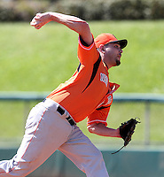 Netherlands National Team pitcher Rob Cordemans #19 delivers a pitch during a spring training exhibition game against the Detroit Tigers at Al Lang Field on March 8, 2012 in St. Petersburg, Florida.  (Mike Janes/Four Seam Images)