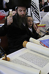 Purim Megillah reading at the Synagogue of the Premishlan congregation in Bnei Brak, a Hasid with a Raashan