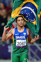 PICTURE BY ALEX BROADWAY /SWPIX.COM - 2012 London Paralympic Games - Day Four - Athletics, Olympic Stadium, Olympic Park, London, England - 02/09/12 - Alan Fonteles Cardoso Oliveira of Brazil celebrates after victory in the Men's 200m T44 Final.