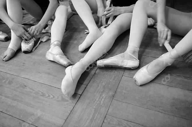 Girls from the third year class at the Vaganova Ballet Academy in St. Petersburg changed into pointes during a daily class. March 18, 2009