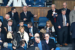 Charles Green takes his seat in the directors box with Andrew Dickson as Malcolm Murray walks down the stairs past him