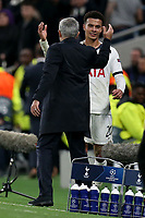 Dele Alli of Tottenham Hotspur  is acknowledged by manager Jose Mourinho after being substituted during Tottenham Hotspur vs Olympiacos FC, UEFA Champions League Football at Tottenham Hotspur Stadium on 26th November 2019