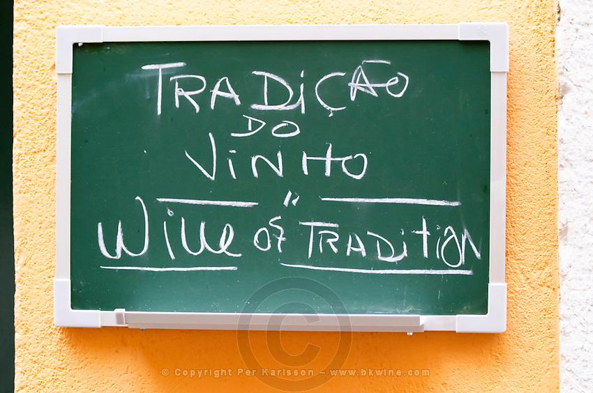 Sign saying traditional wine. Lisbon, Portugal