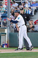Everett AquaSox manager Dave Valle #10 argues a call with home plate umpire Benjamin Bayer during a game against the Vancouver Canadians at Everett Memorial Stadium in Everett, Washington on July 9, 2014.  Everett defeated Vancouver 9-4.  (Ronnie Allen/Four Seam Images)