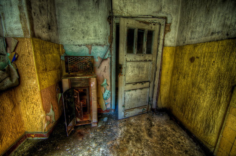 Derelict interior small room in Krampnitz, old tank barracks Germany.