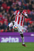 30th September, bet365 Stadium, Stoke-on-Trent, England; EPL Premier League football, Stoke City versus Southampton; Stoke City's Mame Biram Diouf controls a high ball