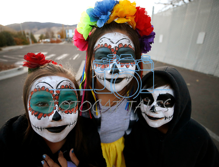 From left, Esmeralda, 10, Cassandra, 11 and Octavio Hernandez, 9, participate in the Carson City Boo-nanza event, in Carson City, Nev., on Tuesday, Oct. 30, 2018. <br /> Photo by Cathleen Allison/Nevada Momentum