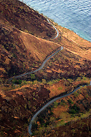 October 28th 2004-Dili, East Timor- A bird's eye view of a road winding it's way across a section of the Timorese coastline as seen from a helicopter.  Photograph by Daniel J. Groshong/Tayo Photo Group