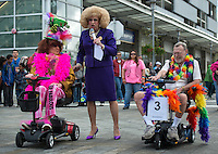 Grand Marshalls of Alaska PrideFest's 2015 Equality Parade Mad Myrna and The Raven owner Larry Kaiser are introduced by parade MC Daphne DoAll LaChores as they lead parade floats through the streets of downtown Anchorage.