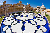 Udaivilas Oberoi Hotel with ornamental water fountain with artistically carved flowers in the courtyard.<br /> (Photo by Matt Considine - Images of Asia Collection)