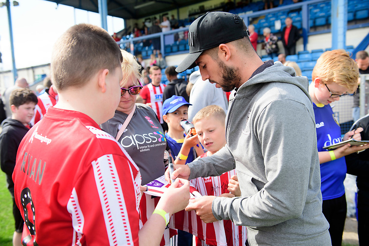Lincoln City's Tom Pett signs autographs for fans<br /> <br /> Photographer Chris Vaughan/CameraSport<br /> <br /> Football Pre-Season Friendly (Community Festival of Lincolnshire) - Gainsborough Trinity v Lincoln City - Saturday 6th July 2019 - The Martin & Co Arena - Gainsborough<br /> <br /> World Copyright © 2018 CameraSport. All rights reserved. 43 Linden Ave. Countesthorpe. Leicester. England. LE8 5PG - Tel: +44 (0) 116 277 4147 - admin@camerasport.com - www.camerasport.com