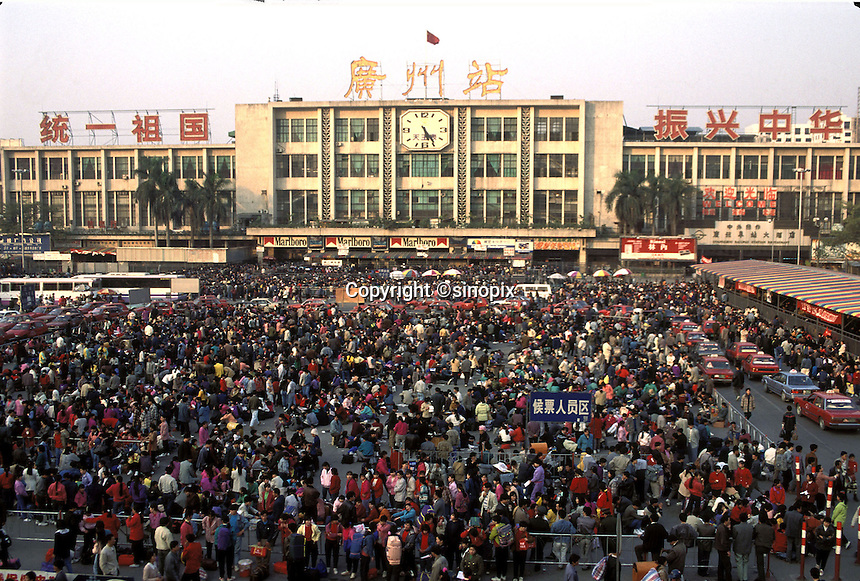 Migrant workers wait at Guangzhou train station to return home for Chinese New Year. Around a 100 million workers return home from often distant  places of work for Lunar Year celebrations.