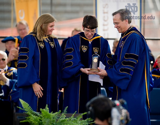May 22, 2011; Rev. John I. Jenkins, C.S.C., president of the University of Notre Dame, presents the Laetare Medal to Joan McConnon  and Sister Mary Scullion, R.S.M.. Scullion and McConnon were awarded the Laetare Medal for their work as co-founders of Project H.O.M.E....Photo by Matt Cashore/University of Notre Dame