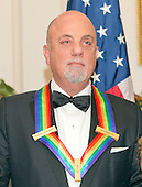 Pianist, singer and songwriter Billy Joel waits to pose for a group photo with the other four recipients of the 2013 Kennedy Center Honors following a dinner hosted by United States Secretary of State John F. Kerry at the U.S. Department of State in Washington, D.C. on Saturday, December 1, 2013.  The 2013 honorees are opera singer Martina Arroyo; pianist, keyboardist, bandleader and composer Herbie Hancock; pianist, singer and songwriter Billy Joel; actress Shirley MacLaine; and musician and songwriter Carlos Santana.<br /> Credit: Ron Sachs / CNP