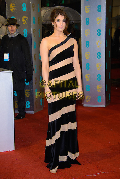 Gemma Arterton.EE British Academy Film Awards at The Royal Opera House, London, England 10th February 2013.BAFTA BAFTAS arrivals  full length dress black beige nude one shoulder stripe.CAP/CJ.©Chris Joseph/Capital Pictures