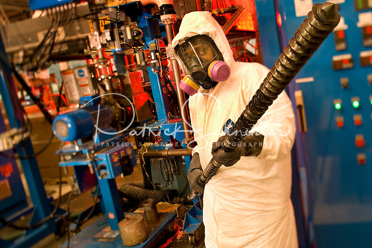 A worker dressed in safety gear at Polymers Center of Excellence in Charlotte. The Polymers Center of Excellence provides state-of-the-art plastics product design, engineering, and analysis services to the medical, transportation, materials handling, packaging, and consumer products industries.