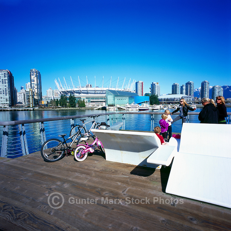 City of Vancouver Skyline, BC Place Stadium (New Retractable Roof completed in 2011), Edgewater Casino, and Rogers Arena viewed from the Seawall at The Village on False Creek (aka Olympic Village), Vancouver, BC, British Columbia, Canada