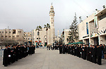 Orthodox Armenian take part in a procession outside the Church of the Nativity in the West Bank town of Bethlehem on Christmas Eve, January 18, 2011. While most Armenians celebrate Christmas on January 6th, the Orthodox Armenians of Jerusalem mark the birth of Jesus on January 18, according to an ancient calendar. Photo by Najeh Hashlamoun