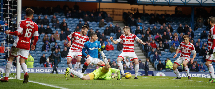 Michael O'Halloran is the solo blue shirt in the box as the keeper spills the ball