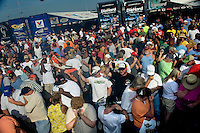 Sept. 19, 2010; Concord, NC, USA; NHRA fans hold their ears and react as a funny car warms up its engine in the pits during the O'Reilly Auto Parts NHRA Nationals at zMax Dragway. Mandatory Credit: Mark J. Rebilas-