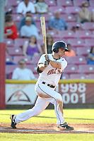 Tyler Hollick #8 of the Salem-Keizer Volcanoes bats against the Eugene Emeralds at Volcanoes Stadium on July 27, 2014 in Keizer, Oregon. Salem-Keizer defeated Eugene, 9-1. (Larry Goren/Four Seam Images)