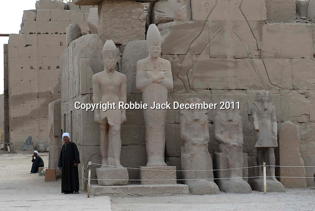 Royal statues in front of the seventh pylon in the Temple complex at Karnak. Karnak is part of the ancient city of Thebes ( built in and around modern day Luxor).The building of the Temple complex at Karnak began in the reign of the Pharaoh Senusret I who ruled Egypt from 1971-1926 BC. Approximately 30 Pharaohs contributed to the building of the complex and in so doing made it the largest ancient religious site in the world. The ancient name for Karnak was Ipet-isut (Most select of places).