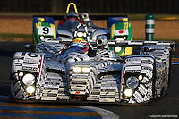 The Dome S101 Judd driven by Jan Lammers, Tom Coronel and Val Hillebrand runs ahead of the Dome S101 Judd of Masahiko Kondo, Ian McKellar Jr. and François Migault during the 2002 24 Hours of Le Mans.