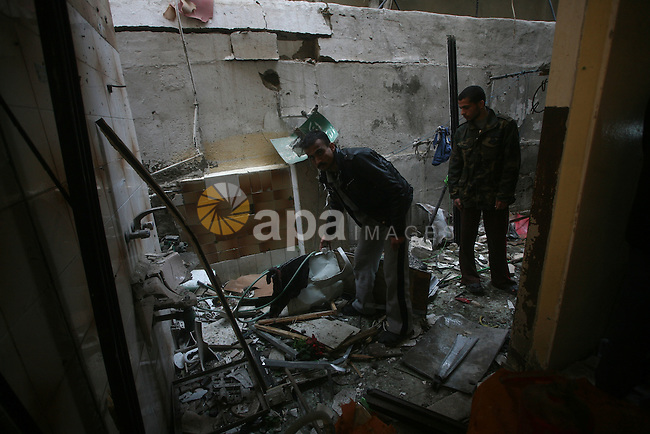 Palestinians inspect damage in their house in Al Shijaia Neighborhood in Gaza city, after an Israeli air strike in Gaza City on 10 March 2012, bringing the number of Palestinians killed in a day of cross-border fighting to twelve. Photo by Ashraf Amra