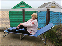 BNPS.co.uk (01202 558833)<br /> Pic: RichardCrease/BNPS<br /> <br /> Gillian Vincent now struggles to see the sea.<br /> <br /> Beach hut owners fury after sea views are blocked...by more beach huts.<br /> <br /> Irate beach hut owners have slammed a council who have allowing a row of beach huts to be built directly in front of them blocking their beautiful sea views.<br /> <br /> Owners who pay &pound;1,094 a year to the council to have a beach hut there will instead have to make do with the view of the back of another beach hut.<br /> <br /> Furious owners in the Manor Steps area in Bournemouth, Dorset, are demanding action after being told of plans to place more huts between them and the beach by the end of the month.<br /> <br /> They claim their views of the sea, beach and prom will be completely blocked and that the council has not consulted them on the plans.<br /> <br /> Bournemouth Borough Council said the move is necessary to allow for the creation of a turning circle for the newly-routed land train.<br /> <br /> Mrs Vincent, who has owned a beach hut for more than 50 years, said: &quot;What's the point of owning a beach hut if all you can see is the back of another hut?