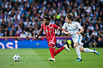 David Alaba (L) of FC Bayern Munich is tackled by Luka Modric of Real Madrid during the UEFA Champions League Semi-final 2nd leg match between Real Madrid and Bayern Munich at the Estadio Santiago Bernabeu on May 01 2018 in Madrid, Spain. Photo by Diego Souto / Power Sport Images