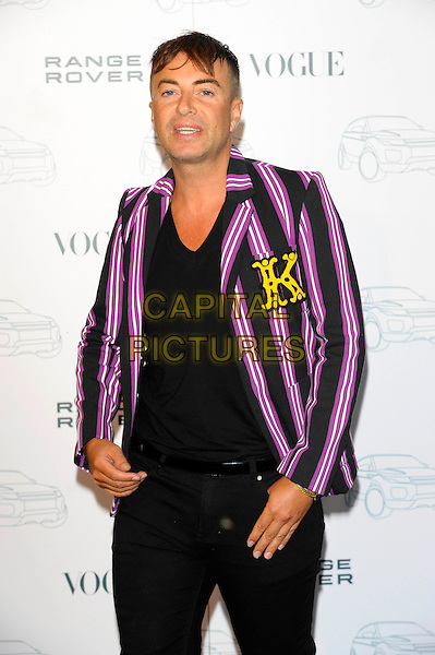 JULIEN MACDONALD.Attends the Range Rover 40th Anniversary Party in association with Vogue at the Orangery, Kensington Palace, London, England, UK..July 1st 2010.half length blazer pink purple striped pinstripe black t-shirt jacket.CAP/CJ.©Chris Joseph/Capital Pictures.