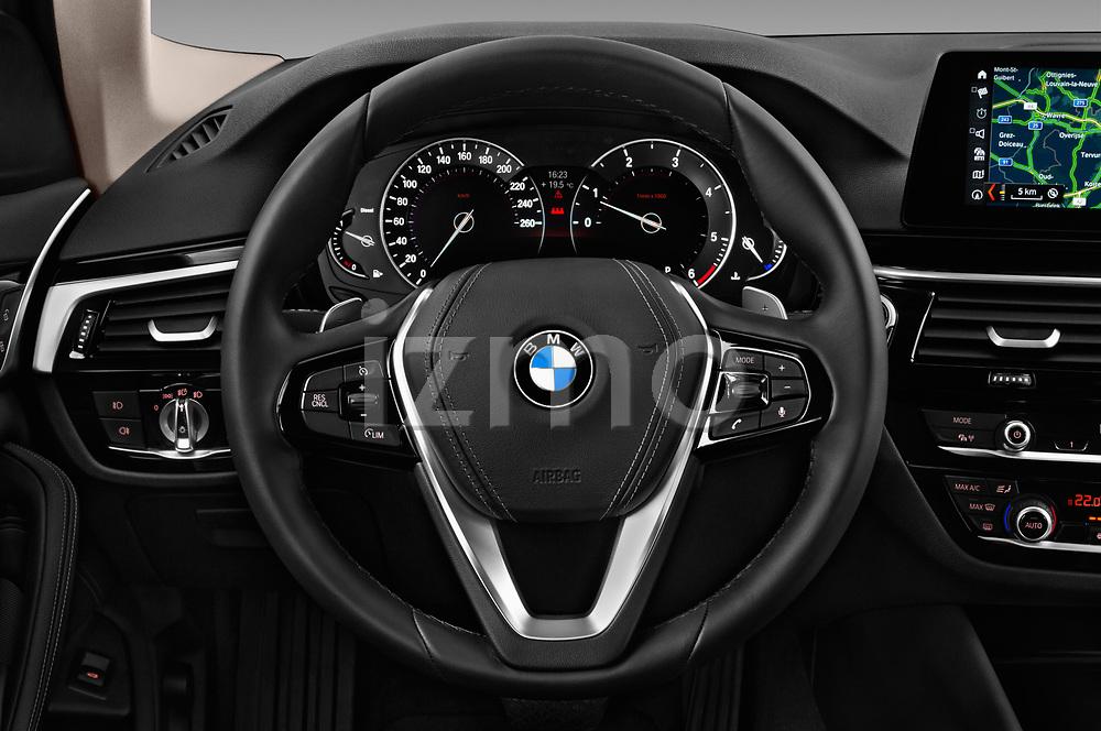 Car pictures of steering wheel view of a 2017 BMW 5-Series Sport 4 Door Sedan Steering Wheel
