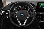 Car pictures of steering wheel view of a 2017 BMW 5-Series Sport 4 Door Sedan Steering Wheel