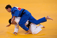 30.07.2012. London, England. Koreas Ki-Chung Wang (KOR) in white defeats Rinat Ibragimov (KAZ) in blue in the Mens 73kg kg Elimination Round of 32 during the Judo Preliminaries on Day 3 of the London 2012 Olympic Games at ExCeL.