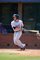 Pensacola Blue Wahoos shortstop Blake Trahan (32) follows through on a swing during a game against the Mobile BayBears on April 26, 2017 at Hank Aaron Stadium in Mobile, Alabama.  Pensacola defeated Mobile 5-3.  (Mike Janes/Four Seam Images)