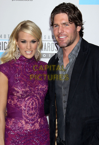 Carrie Underwood, Mike Fisher.40th Anniversary American Music Awards - Arrivals held at Nokia Theatre L.A. Live, Los Angeles, California, USA..November 18th, 2012.AMA AMAs half length dress purple pink sequins sequined lace high collar gold   black suit grey gray shirt married husband wife stubble facial hair .CAP/ADM/RE.©Russ Elliot/AdMedia/Capital Pictures.