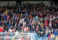 The Accrington Stanley fans celebrate their teams victory after the Sky Bet League 2 match between Wycombe Wanderers and Accrington Stanley at Adams Park, High Wycombe, England on the 30th April 2016. Photo by Liam McAvoy / PRiME Media Images.