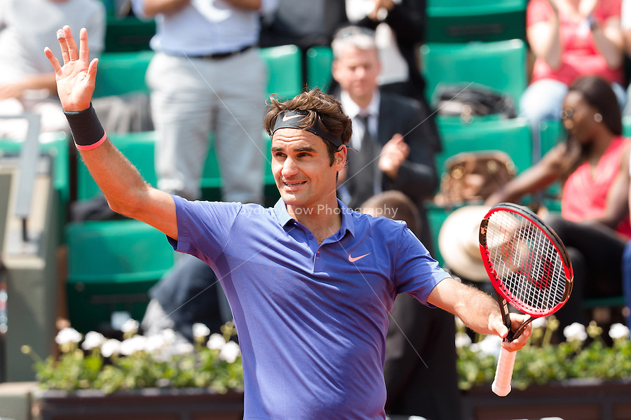 May 27, 2015: Roger Federer of Switzerland celebrates his win in a 2nd round match against Marcel Granollers of Spain on day four of the 2015 French Open tennis tournament at Roland Garros in Paris, France. Sydney Low/AsteriskImages