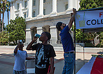 With temperatures hitting over one hundred degrees in Sacramento members of the Capitol Sikh Center set up a free lemonade and water stand on the south side of the State Capitol Building in Sacramento, California on Wednesday, July 27, 2016.  Photo/Victoria Sheridan